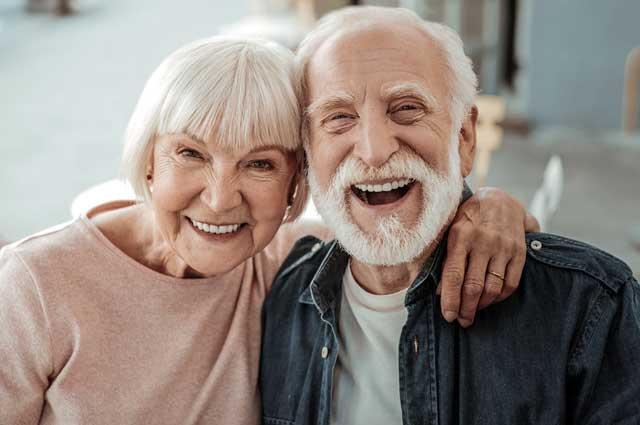Smiling elderly senior couple laughing